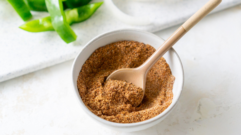 taco seasoning in small bowl with spoon