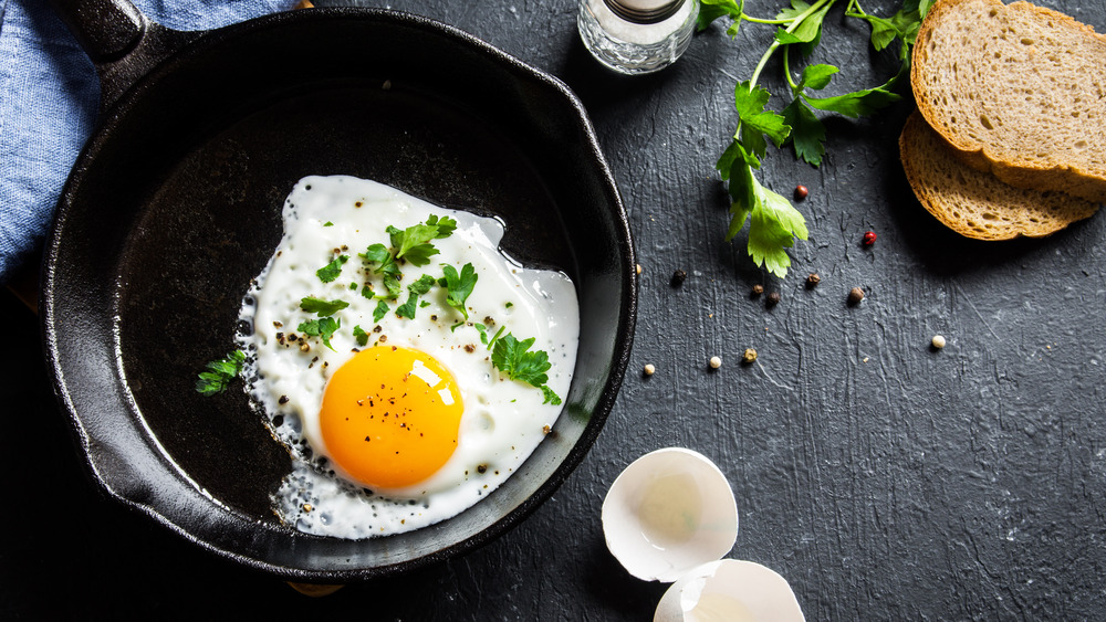 Here's How To Stop Eggs From Sticking To Your Cast Iron Skillet
