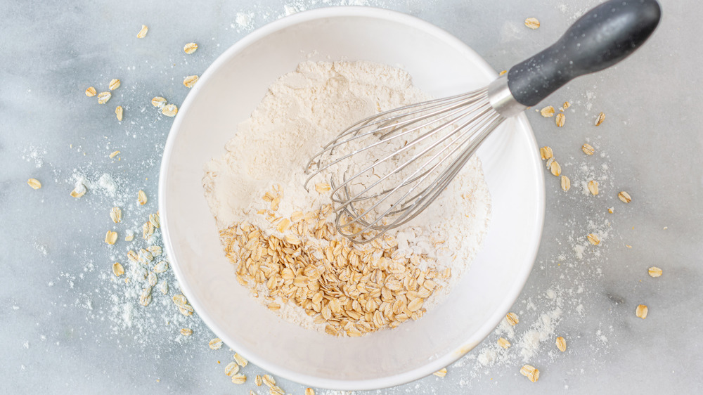mixing flour and oats