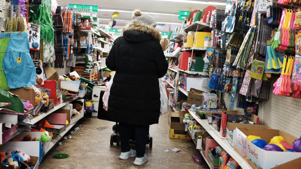 Woman shopping at a Dollar Tree