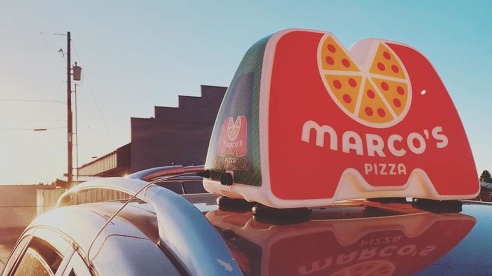 Marco's Pizza delivery sign on car